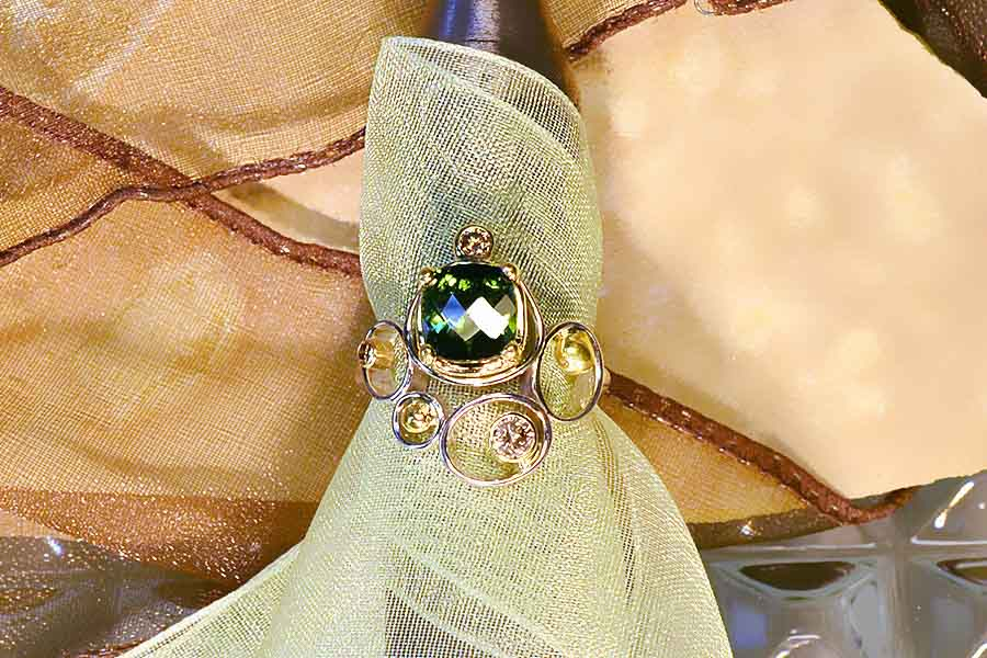 14K-YELLOW-AND-WHITE-GOLD-SET-WITH-A-GREEN-TOURMALINE-AND-DIAMONDS